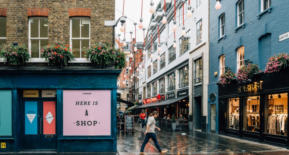 commercial-street-with-shops-in-london-on-a-rainy-day-and-an-empty-storefront-on-rent_t20_GGW6Oo