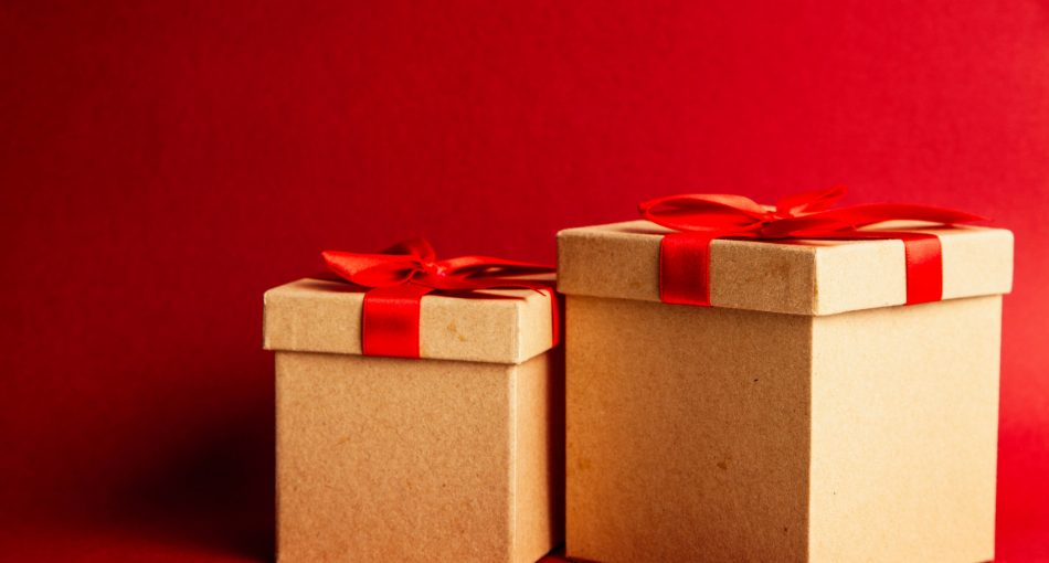 two-brown-and-red-gift-boxes-on-red-surface-1666070